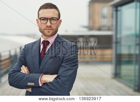 Confident Stylish Businessman On A Balcony