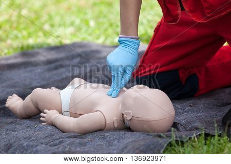 Baby CPR dummy first aid training. Cardiopulmonary resuscitation - CPR. Cardiac massage.