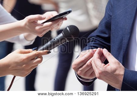 Press interview. Reporters making media interview with businessman or politician.