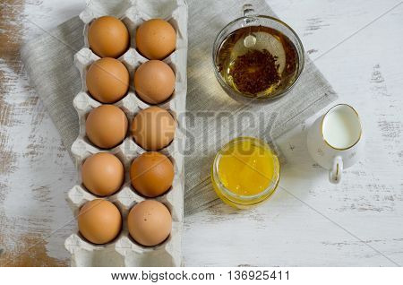 Breakfast Setting - Eggs In A Cardboard Tray, Milk In A Jug, Green Tea And Honey