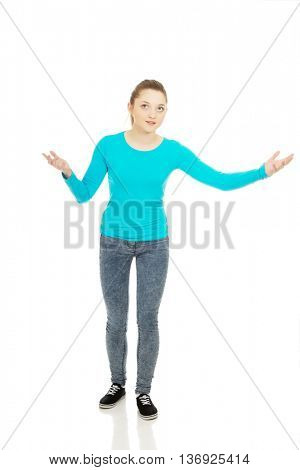 Teen woman holding something on hands.