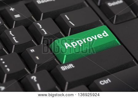 Keyboard with the word approved on green button.
