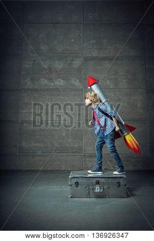 Little boy with a rocket