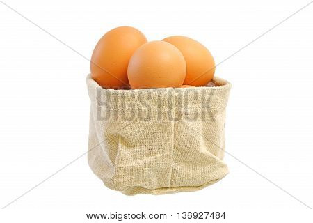 egg on wooden board vintage style in small sack isolated on white background