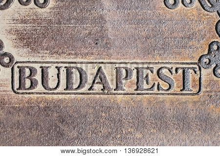 Budapest city sign on aged iron plate on metallized background
