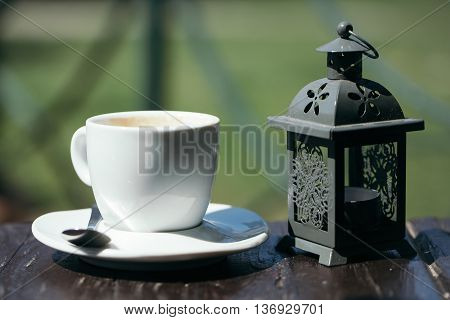 Lantern And Cup Of Coffee