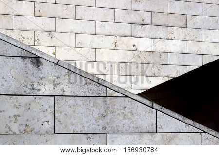 modern building exterior fragment, brick walls. Triangle form. Creative background. Copy space