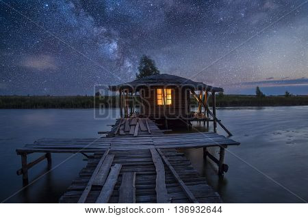 Starry Skies Over Water Villa Cottages On Maldives. Elements Of This Image Furnished By Nasa