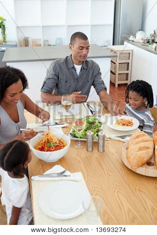 Loving family dining together in the kitchen