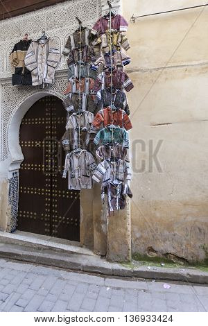 Picturesque small street in souk of Fez medina (old town) with muslim and tourists