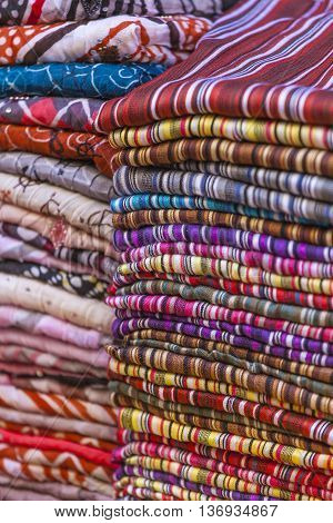 Colorful Fabrics And Carpets For Sale On A Street In Medina Of Essaouira, Morocco
