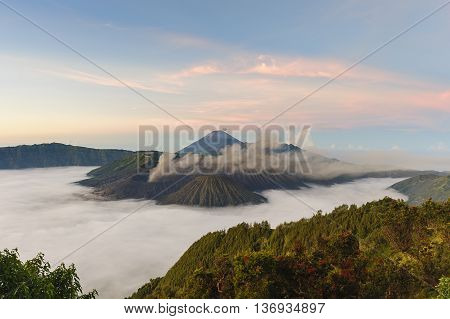 Beautiful morning view of Mount Bromo in Tengger Semeru National Park East Java Indonesia during beutiful sunrise with the valley full of sea cloud.