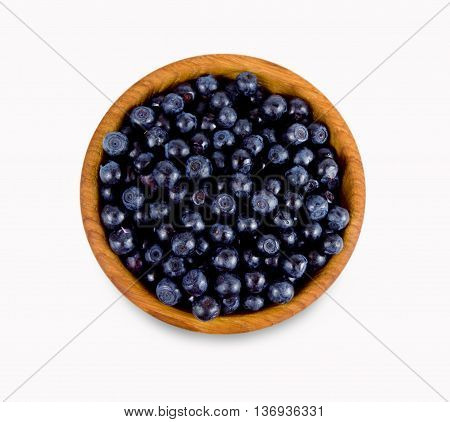 Ripe and tasty bilberries isolated on white background.