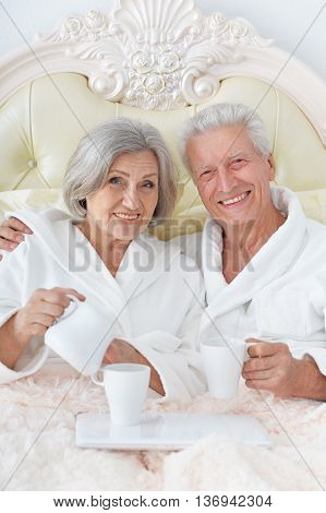 happy Senior couple  in bed  with coffee