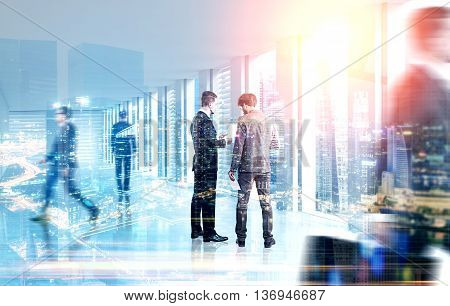 Back view of businessmen discussing something on city background with sunlight. Teamwork concept. Double exposure