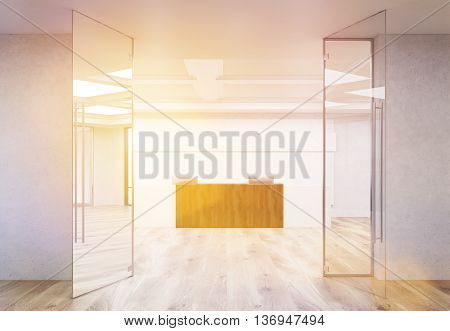 Front view of interior with wooden office reception stand parquet flooring concrete walls and ceiling behind glass doors. Toned image 3D Rendering