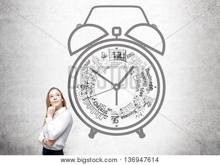 Time management concept with thoughtful businesswoman against concrete wall with alarm clock sketch