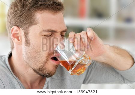 man with whiskey in glass , alcoholism problem , alcohol abuse concept