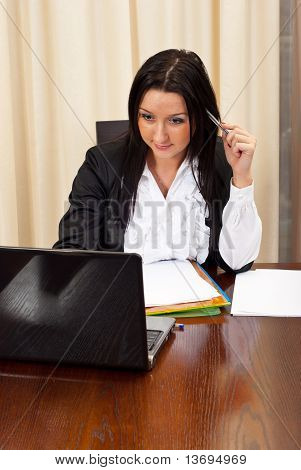 Thinking Business Woman Working