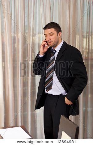 Worried Business Man Talking On Phone Mobile