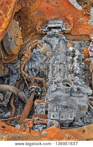 Destroyed and rusty car engine in a terrorist explosion and fire