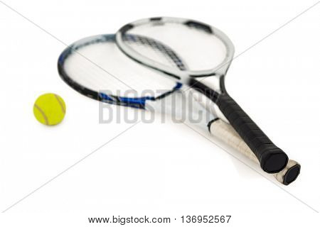 Tennis ball and rackets on isolated white background