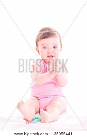 Beautiful baby girl clap her hands on white background.