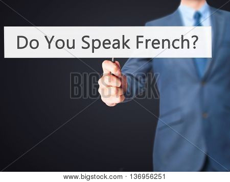 Do You Speak French ? - Businessman Hand Holding Sign