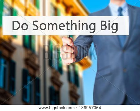 Do Something Big - Businessman Hand Holding Sign