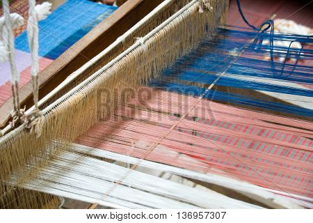 Close up Loom weaving silk in thailand