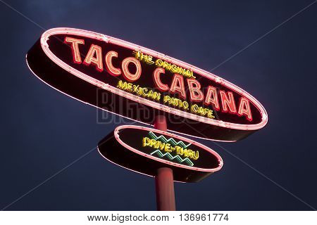 DALLAS Tx USA - APR 17 2016: Taco Cabana Mexican fast food restaurant logo illuminated at night. Dallas Texas United States