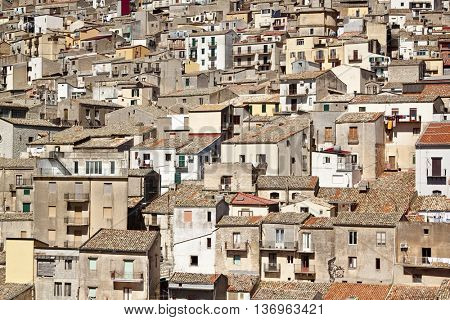 View of houses in Prizzi, small town on a hillside, Sicily