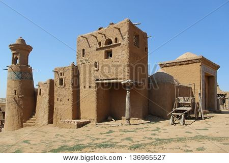 adobe buildings of the old fortress against the blue sky