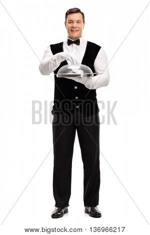Full length portrait of a young waiter holding an empty tray with a plastic lid isolated on white background