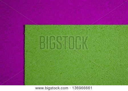 Eva foam ethylene vinyl acetate apple green surface on pink sponge plush background