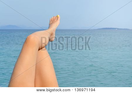 Woman Legs By The Seaside Enjoying Sunny Day