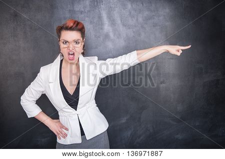 Angry Screaming Teacher Pointing Out Blackboard Background