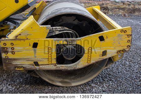 new road roller flattening asphalt closeup cylinder