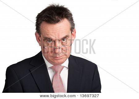 Stern Businessman looking over Glasses