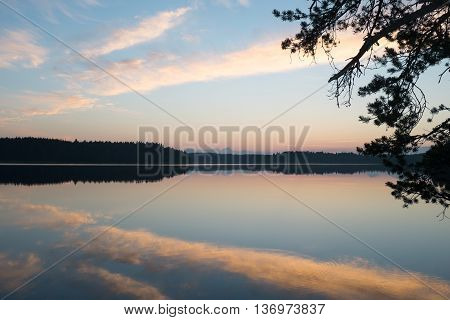 Midnight summer sunset and beautiful lake view in Finland.