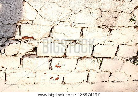 Abstract weathered texture stained old stucco aged paint white brick wall background