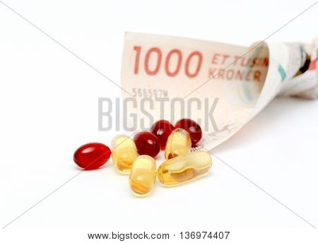 picture of a Cod liver oil omega 3 gel capsules with 1000 danish kroner currency bank note