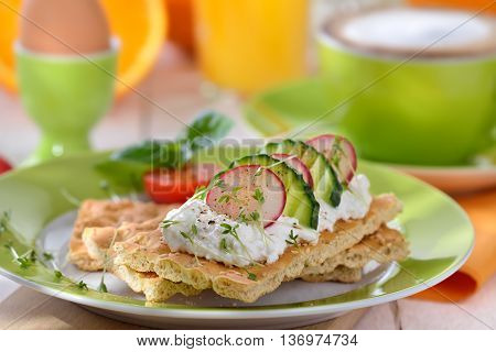 Light breakfast with cottage cheese crispbread and a cup of cappuccino