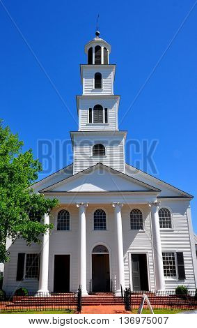 New Bern North Carolina - April 24 2016: 1822 First Presbyterian Church with tiered steeple and entrance portico on New Street *