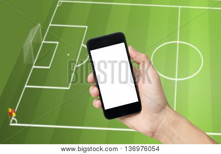Hand holding mobile phone view live soccer euro game on mobile phone and football field background.