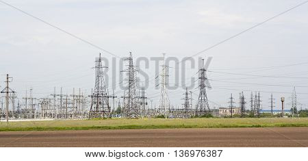 forest from high voltage pillars industrial landscape