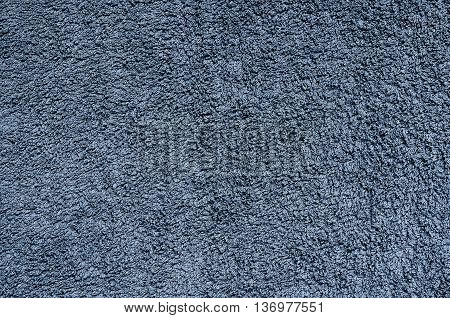 Terry towel texture. Close-up navy blue material structure may be used as background.