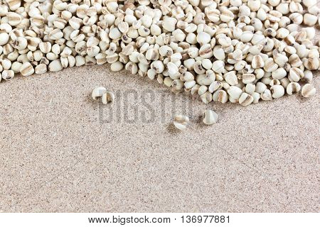 cereal Job's tears on wooden bagasse board. A pile is the curve line.