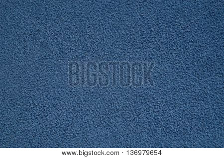 Furry blanket texture. Close-up of blue textile material may be used as background.