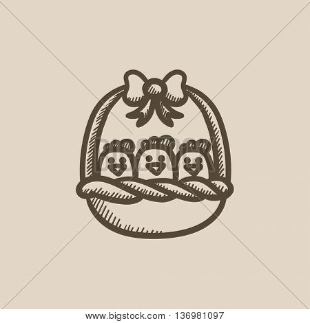 Basket full of easter chicks vector sketch icon isolated on background. Hand drawn Basket full of easter chicks icon. Basket full of easter chicks sketch icon for infographic, website or app.